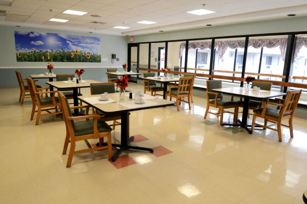 Dining room, tables, chairs at Norwalk.