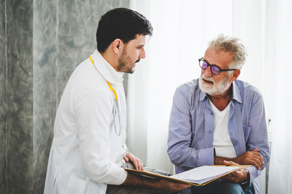 Professional psychologist doctor discussing with patient in therapy sessions at hospital room
