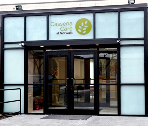 Glass entranceway and signage for Cassena Care at Norwalk.
